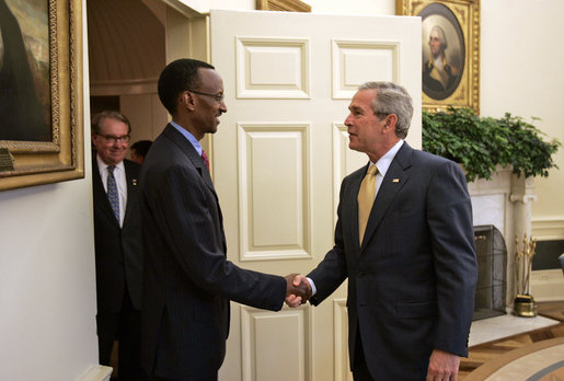 George W. Bush greets Paul Kagame in the Oval Office at the White House.