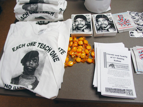 At this year's observance of Lil Bobby Hutton Day, the connection between Lil Bobby and Oscar Grant, two unarmed young Black men executed in cold blood by police in Oakland – one in 1968 and the other in 2009 – was clearly drawn by the selection of commemorative items placed on this table. – Photo: Dave Id, Indybay