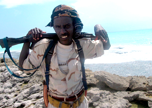 A Somali pirate stands guard on the coast of Hobyo, where his compatriots were holding the Greek tanker MV CPT Stephanos last October. According to early reports, the three Somali pirates killed by the U.S. Navy Sunday were teenagers – 16-19 years old. – Photo: © Badri Media/E.P.A./Corbis