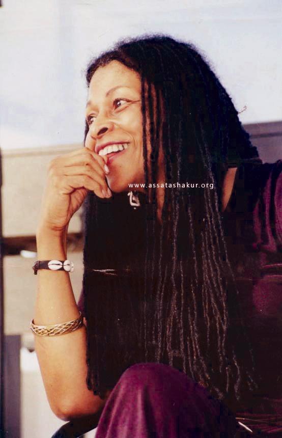 http://www.sfbayview.com/wp-content/uploads/2009/05/assata-shakur-braids-smiling.jpg