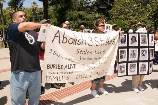 One of the top missions of Caravan for Justice III is the abolition of the Three Strikes law that has ripped apart families and impoverished the state of California. These demonstrators played a major role in the third caravan to Sacramento on May 26. – Photo: Scott Braley