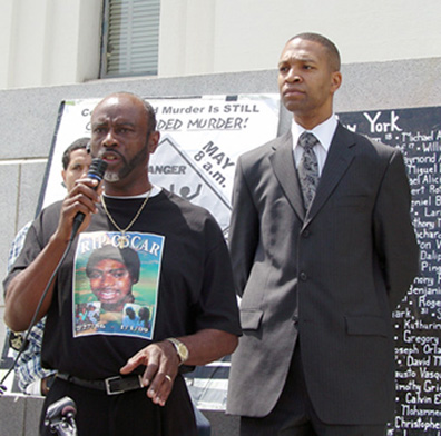 As killer cop Johannes Mehserle's preliminary hearing adjourned Monday, Oscar Grant's Uncle Bobby (Cephus) Johnson came out to report to the crowd and thank them for their support. Minister Keith Muhammad, who leads the townhall meetings held every Saturday afternoon in Oakland since Oscar Grant's murder, stands behind him. – Photo: Dave Id, Indybay