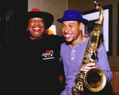 Ruth Dewson of Mrs. Dewson's Hats and jazz musician Joshua Redman with their crowns