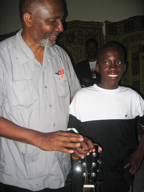 Fr.-Gerard-Jean-Juste-Rosemond-Jolissaint-in-Port-au-Prince-web, A musical tribute to Fr. Jean-Juste by Rosemond Jolissaint, Radio & Audio