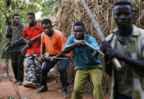 Villagers who have formed a local self defense force move during a training session in the village of Bangadi in northeastern Congo Feb. 18, 2009. In the face of attacks and massacres by the Ugandan Lord's Resistance Army (LRA), who had slaughtered some 900 Congolese civilians since December, the villagers, using locally made weapons, have twice repelled LRA attacks in recent months. – Photo: Finbarr O'Reilly, Reuters
