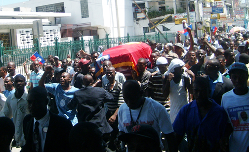 fr-gerard-jean-juste-haiti-funeral-march-with-coffin-outside-cathedral-061809-by-c2a92009-jean-ristil-hip-web, A funeral and a boycott: 'The struggle continues' in Haiti, World News & Views