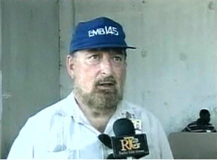 Brazilian ambassador Igor Kipman tries to put an upbeat spin on the elections as he is interviewed in an empty polling station. – Photo: ©2009 Ronald Fareau, HIP