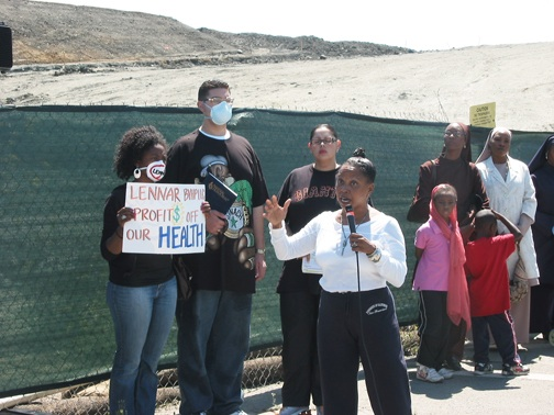 Dr. Ahimsa Sumchai, physician and candidate for mayor of San Francisco, talked to the crowd about the shipyard's history, Lennar's corrupt practices and the City's complicity. – Photo: Chris Brizzard