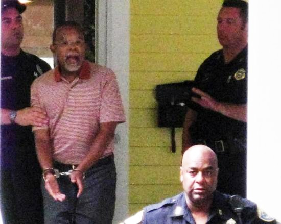 In this photo taken by a neighbor, Harvard professor Henry Louis Gates Jr. is arrested at his home in Cambridge. – Photo: Bill Carter, Demotix Images