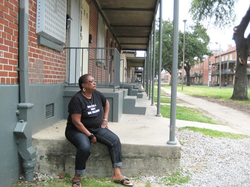 Public housing advocate and former resident Sharon Jasper rests on the steps of Iberville – still empty yet still standing – the only remaining major public housing development in New Orleans. – Photo: Eric Tars