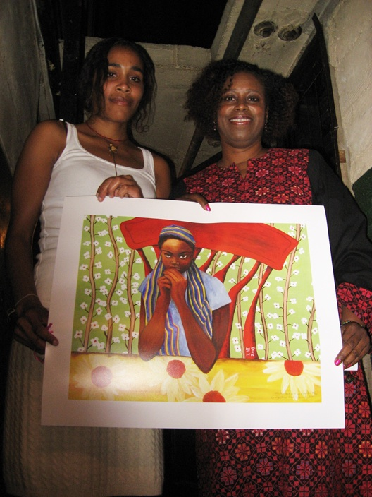 "Back stage at the Grand Lake Theater Aug. 20, artist Nia Imara surprised Cynthia McKinney with the gift of her painting, ""All Little Black Girls Are Alike II,"" a beautiful 20 by 24-inch art print on archival paper. Nia also sold two more of the prints that night and donated all the proceeds to the Bay View. – Photo: Wanda Sabir"