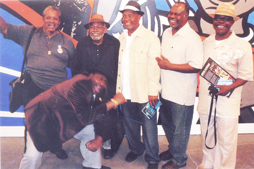 Emory Douglas' art exhibit reception at the New Museum in New York City July 21 drew many Panthers and Panther cubs and their comrades, among them C. Innis, Amiri Baraka, Emory, Tony, Bill X and, in front, William Johnson. Innis and Johnson were NY Panthers in the '60s and '70s. Black August was founded to honor George Jackson, field marshal for the Black Panther Party. – Photo courtesy www.itsabouttimebpp.com