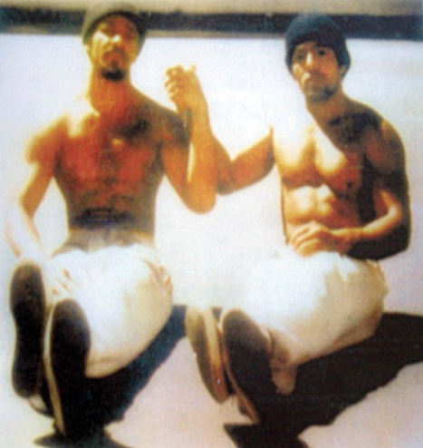"""Khatari Gaulden and Hugo """"Yogi"""" Pinell sit together in the San Quentin yard."""