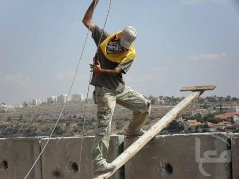 Nilin-climbing-roping-wall-0918091, Ni'lin protesters tear down apartheid wall, World News & Views