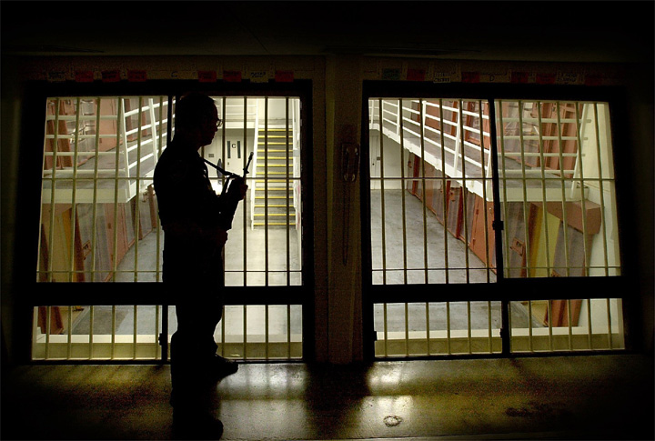 Pelican Bay Prison Guard George Sherman carries a rifle in the control room of the ultra-maximum Security Housing Unit, known as the SHU, whenever a guard enters one of the groups of 10 cells. - Photo and caption: John Burgess, Santa Rosa Press Democrat