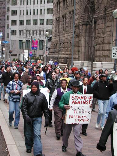 The March for Jobs will step off from Hill district landmark Monumental Baptist Church at 2 p.m. Sunday, Sept. 20. Here, Monumental's Pastor Tom Smith leads a march on March 22, 2003.