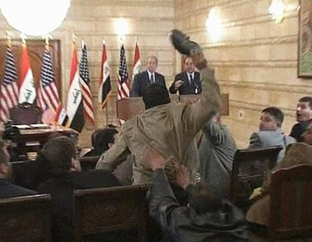 "At a press conference on George W. Bush's final visit to Iraq as U.S. president Dec. 14., 2008, Mutadhar al-Zeidi shot up from his chair and hurled his shoes, one by one, toward Bush at the podium, shouting with the first, ""This is your farewell kiss, you dog!"" and, with the second, ""This is from the widows, the orphans and those who were killed in Iraq."""