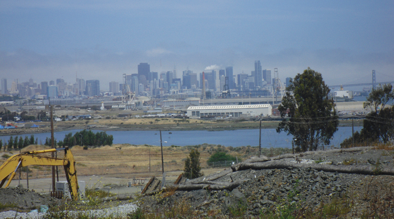 The view of the San Francisco skyline, the Bay Bridge and the shoreline of San Francisco Bay from the Hunters Point Shipyard is a priceless asset acquired by Lennar when the Navy and the City transferred the Shipyard's Parcel A to the notorious Florida-based mega-homebuilder for one dollar. – Photo: MIT.edu