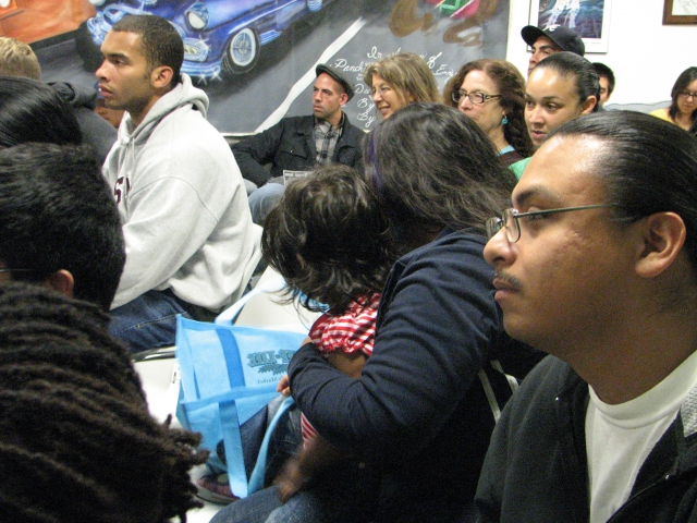 A large and diverse audience at Barrios Unidos in Santa Cruz paid rapt attention to M1 on Sept. 28. - Photo: Sandino