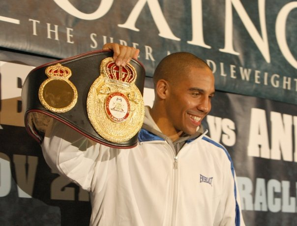 "The new World Boxing Association (WBA) Middleweight Champion of the World Andre ""Son of God"" Ward of Oakland shows off his championship belt at the post-fight press conference. – Photo: Malaika Kambon"