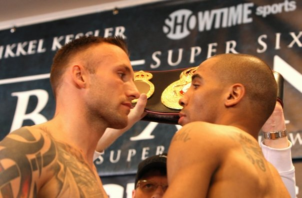 "The stare down at the pre-fight weigh-in: The heavily favored Mikkel ""The Viking Warrior"" Kessler from Denmark cannot intimidate Andre ""Son of God"" Ward from Oakland. – Photo: Malaika Kambon"
