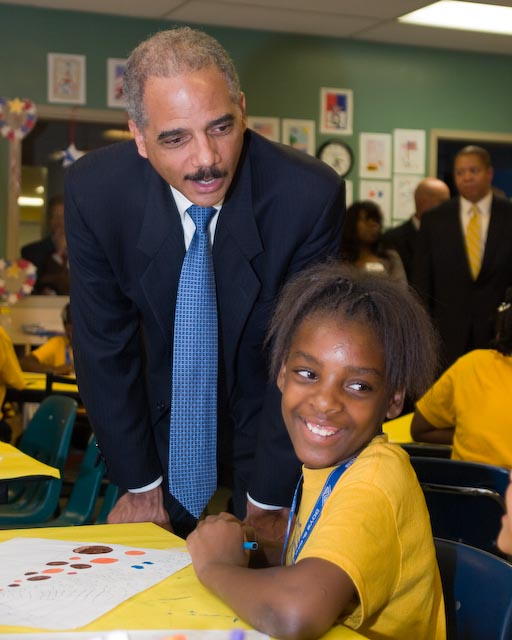Attorney General Eric Holder talks with the children at the Challengers Boys & Girls Club in Los Angeles in July. – Photo: Dennis Lovelace, Lovelace Media, LA Sentinel