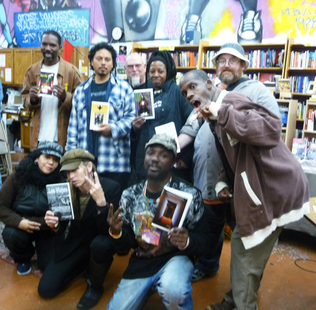 """POOR Press authors display their newly published books at a recent event on their """"Taking Back the Land, One Story at a Time Tour"""" held at Revolution Books: from left, upper row, Marlon Crump, Tony Robles, Queennandi Xsheba, Thorton Kimes and Leroy Moore; from left, below, Vivian Hain, Tiny and Ruyata/RAM. – Photo: PNN"""