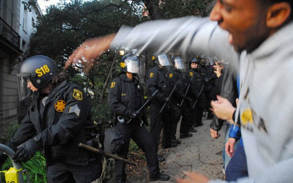 Although the students were simply exercising their constitutional rights to assemble and speak out, police moved in and attacked them viciously, breaking bones with their batons. – Photo: Daily Cal