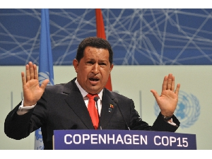 """Venezuelan President Hugo Chavez, speaking at the climate change summit in Copenhagen, called the United States """"the great polluter"""" and accused President Barack Obama of trying to fix a climate deal behind the backs of other leaders: """"The emperor who comes in the middle of the night and in the darkness, then behind everyone's back and in an anti-democratic way cooks up a document. ... That we will not accept."""" – Photo: Buenos Aires Herald"""