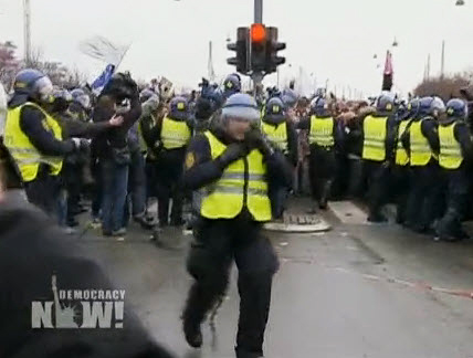 """Baba Jahahara reports that """"more than half of Denmark's 10,500 police officers were assigned to the Bella Center alone, site of the U.N. gathering."""" Here they beat back marchers approaching the Bella Center to meet poor nations and Indigenous delegates who walked out in protest Thursday. – Video frame: Democracy Now!"""