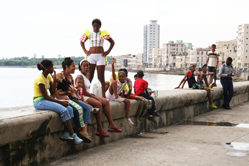 Cuban youth and families gather along the Malecon, a long, broad seawall promenade in Havana. – Photo: Flako
