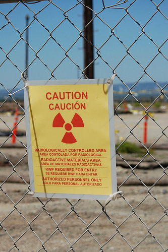 This is one of many warning signs preventing entry to large areas in the Hunters Point Shipyard, a Superfund site and one of the most contaminated places in the U.S. – Photo: KQED Quest