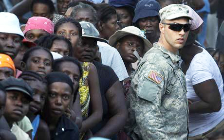 Haiti-earthquake-2000-people-unhappy-with-US-soldier-012010-by-AP, Venezuela steps up aid effort to Haiti, questions U.S. military deployment, World News & Views