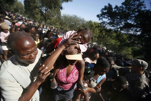 Haiti-earthquake-lined-up-for-aid-012110-by-Reuters1, Kouraj cherie: Dispatches from Port au Prince, Haiti, World News & Views
