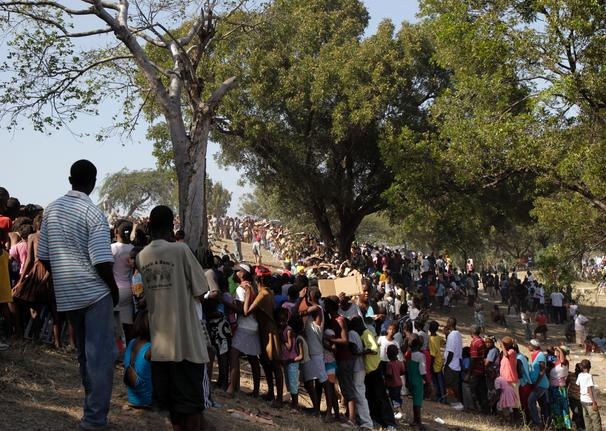 Haiti-earthquake-people-wait-in-line-for-relief-supplies-011810-by-Jae-C.-Hong-AP, From Cynthia McKinney: An unwelcome Katrina redux, World News & Views