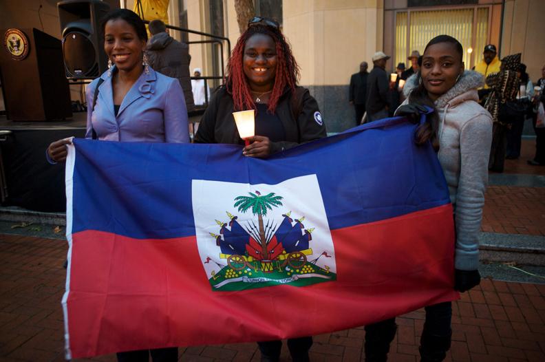Haiti-earthquake-victims-vigil-Ifonia-Gelin-Yolanda-Bellot-Shirley-Bellot-hold-Haitian-flag-Oakland-Fed-Bldg-011810-by-Kamau-web, Earthquake in Haiti: Under Aristide, Haitians were prepared for disaster, World News & Views