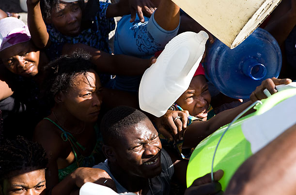 Haiti-earthquake-waiting-for-water-from-a-tanker-truck-0110-2-by-Timothy-Fadek-Polaris-for-TIME, Haiti: NGOs and relief groups call for immediate and widespread distribution of water and other aid, World News & Views