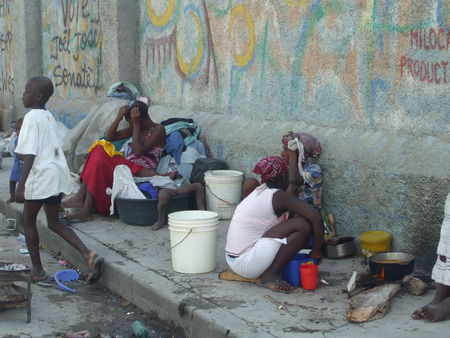 Haiti-earthquake-life-on-sidewalk-sick-child-in-bucket-bed-PAP-020810-by-Flavia-Cherry, Haiti from the front lines: Genocide by omission, World News & Views