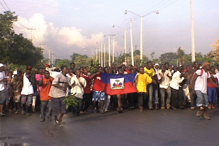 Haiti-earthquake-march-after-first-rain-no-shelter-PAP-021110-by-HIP, Protesters clash with police following rain in Haiti, World News & Views