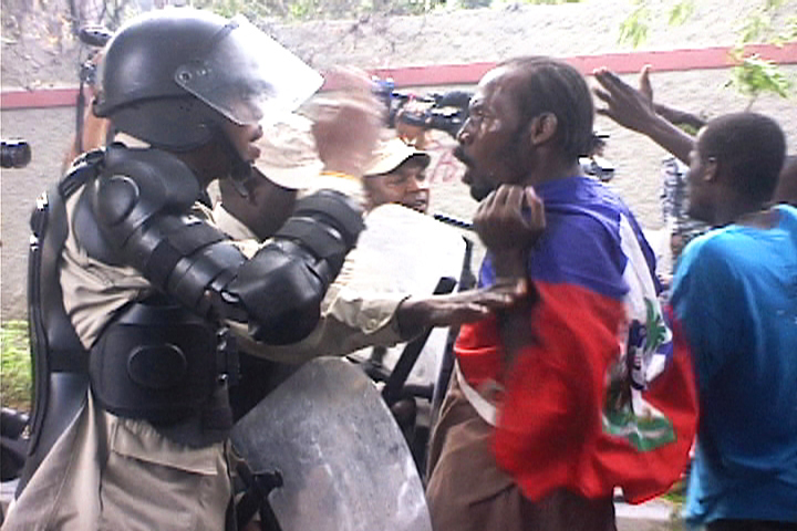 Haiti-earthquake-protester-vs.-Haitian-police-blocking-march-to-UN-HQ-021110-by-HIP, Protesters clash with police following rain in Haiti, World News & Views