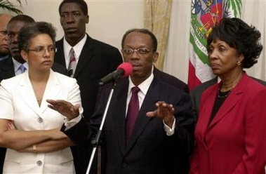 Aristides-Mildred-Jean-Bertrand-Maxine-Waters-press-conf-in-Palace-022104-by-Pablo-Aneli-AP, House vote imminent on Rep. Maxine Waters' bill to cancel Haiti's debt, World News & Views