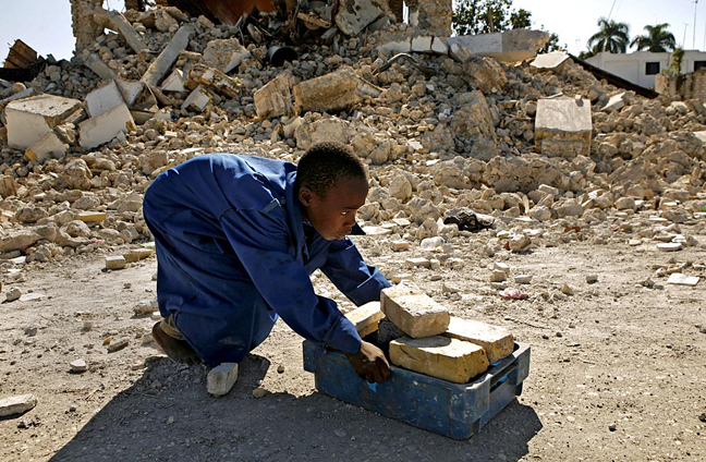 Haiti-earthquake-Angelo-Meyanse-13-collects-bricks-from-old-church-where-Dessalines-married-for-new-home-011810-by-Carolyn-Cole-LA-Times-web, Those who would destroy Haiti would destroy all sovereign peoples, World News & Views