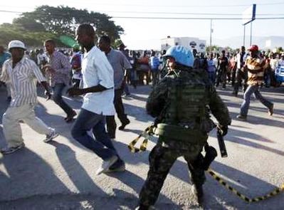 Haiti-earthquake-Brazilian-UN-soldier-run-out-by-Haitians-seeking-jobs-at-UN-airport-compound-011910-by-Wolfgang-Rattay-Reuters, Those who would destroy Haiti would destroy all sovereign peoples, World News & Views