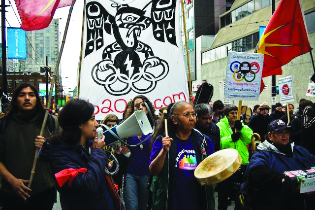 Indigenous-celebrate-Olympic-Games-Over-030210-by-No-2010, Native Youth Movement's war for land and freedom continues, World News & Views