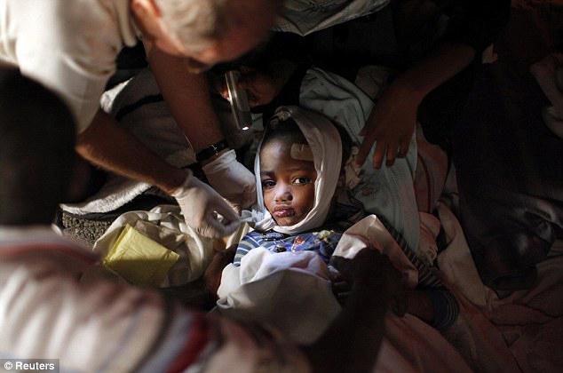Haiti-earthquake-child-rescued-treated-0110-by-Reuters, Haiti help or Haiti hoodwink?, World News & Views