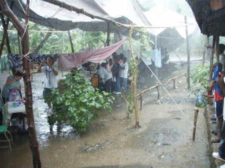 Haiti-rain, Katrina victims see their reflection in Haiti, offer help, National News & Views