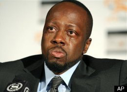 Wyclef-Jean-sheds-tear-0110-by-AP, Haiti help or Haiti hoodwink?, World News & Views
