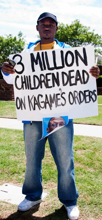 Anti-Kagame-protest-at-Oklahoma-Christian-University-3-mil-children-dead-sign-re-Congo-043010-by-Kendall-Brown, Lawsuit alleges Rwandan President Kagame's guilt in Rwanda Genocide and Congo War, World News & Views
