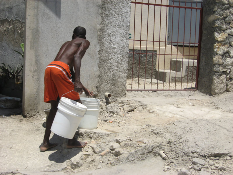 Haiti-earthquake-fetching-water-0410-by-Wanda, Haiti Awareness Day and Celebration Tuesday, May 18, Culture Currents