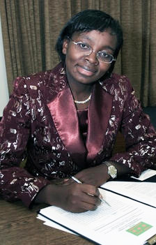 Victoire-Ingabire-Umuhoza-in-red-satin-lapels-writing, Criminal defense lawyers dispute Rwanda's genocide history, World News & Views